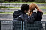 image: couple on bench